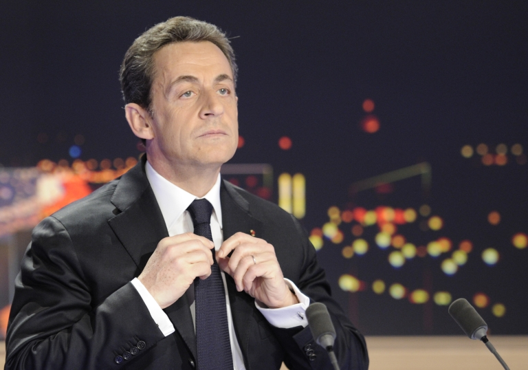 <p>French President Nicolas Sarkozy poses today prior to taking part in a TV newscast outside Paris.</p>