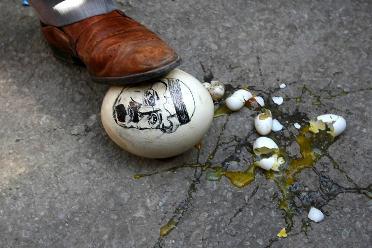 <p>A demonstrator steps on an ostrich egg with a drawing of Saudi Arabia's King Abdullah on March 17, 2011 in front of the Saudi Arabia Embassy in Ankara as he attends a demonstration in support of mainly-Shiite demonstrators in Bahrain and denouncing the intervention by Saudi troops.</p>