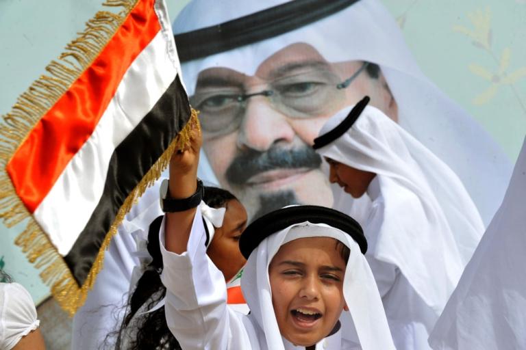 <p>Saudi children celebrate as they greet the convoy transporting King Abdullah bin Abdul Aziz upon his arrival in the Saudi capital Riyadh on Feb. 23, 2011.</p>