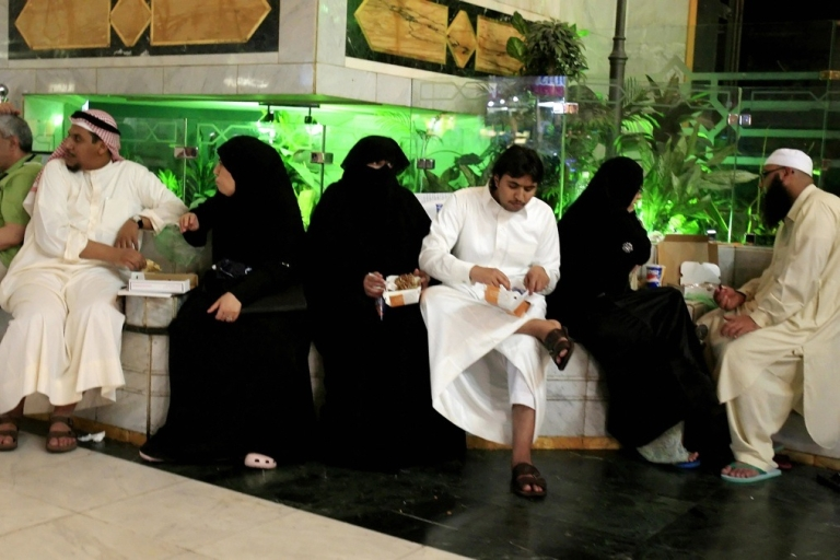 <p>Saudi and foreign Muslims eat fast food inside a shopping mall in the holy Muslim city of Mecca in Saudi Arabia on June 4, 2008.</p>