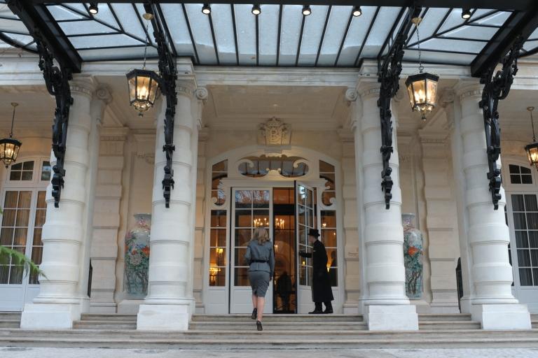 <p>A groom opens the door of the luxury Shangri-La Hotel in Paris.</p>