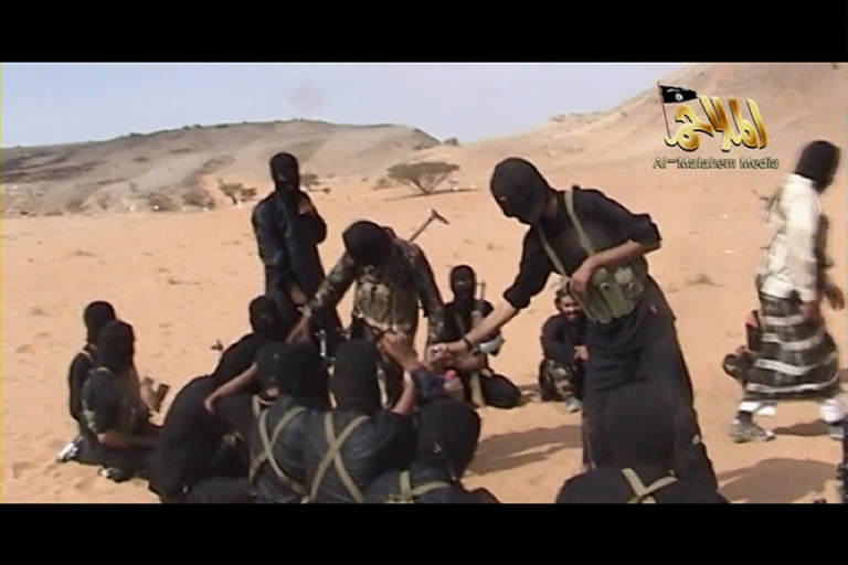 <p>A screen shot of a video posted on the internet on October 6, 2010 shows militants from Al Qaeda in the Arabian Peninsula. Fifty men suspected of links to Al Qaeda were put on trial in Saudi Arabia on April 7, 2012.</p>