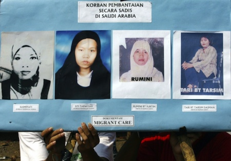 <p>Activists shows a placard displaying photos of abused Indonesian women migrant workers during a 2007 demonstration in front of Saudi Arabian embassy in Jakarta.</p>