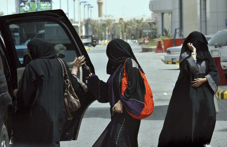 <p>Saudi women get into the backseat of a car in Riyadh on June 14, 2011, three days before a June 17 nationwide campaign by Saudi women who are planning to take the wheel in protest against a driving ban which is unique to the kingdom that applies a strict version of Sunni Islam.</p>