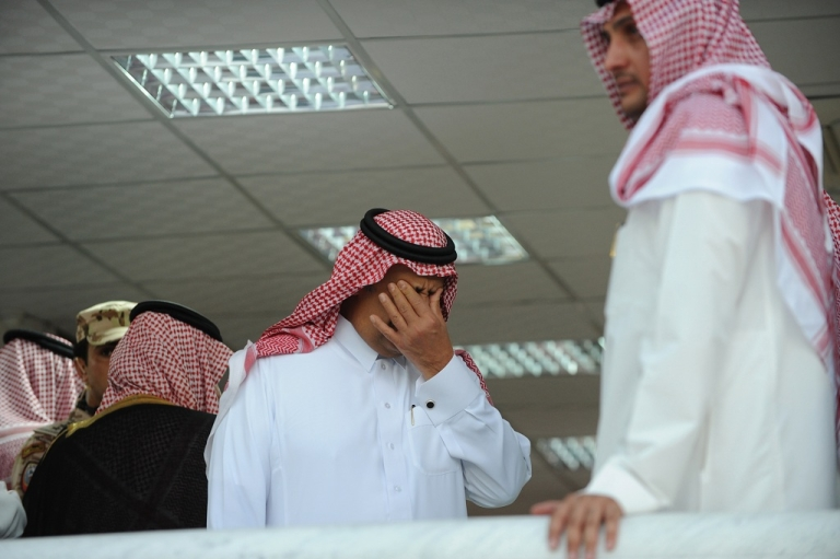<p>Saudi Arabia's deputy defense minister Prince Khaled bin Sultan mourns during the funeral of Crown Prince Nayef bin Abdul Aziz in the Grand Mosque in Mecca.</p>