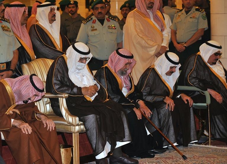 <p>Ailing Saudi King Abdullah bin Abdel Aziz (2L) wears a surgical mask as he prays alongside family members during the funeral of his brother, the late Saudi Crown Prince Sultan bin Abdel Aziz, at Imam Turki bin Abdullah mosque, on October 25, 2011, in Riyadh.</p>