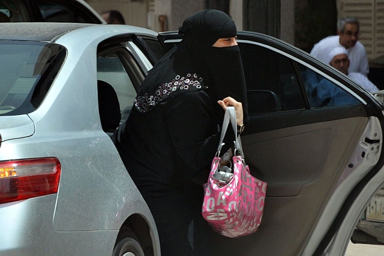 <p>A Saudi woman gets out of a car after being given a ride by her driver in Riyadh on May 26, 2011 as a campaign was launched on Facebook calling for men to beat Saudi women who drive their cars in a planned June protest against the ultra-conservative kingdom's ban on women taking the wheel.</p>