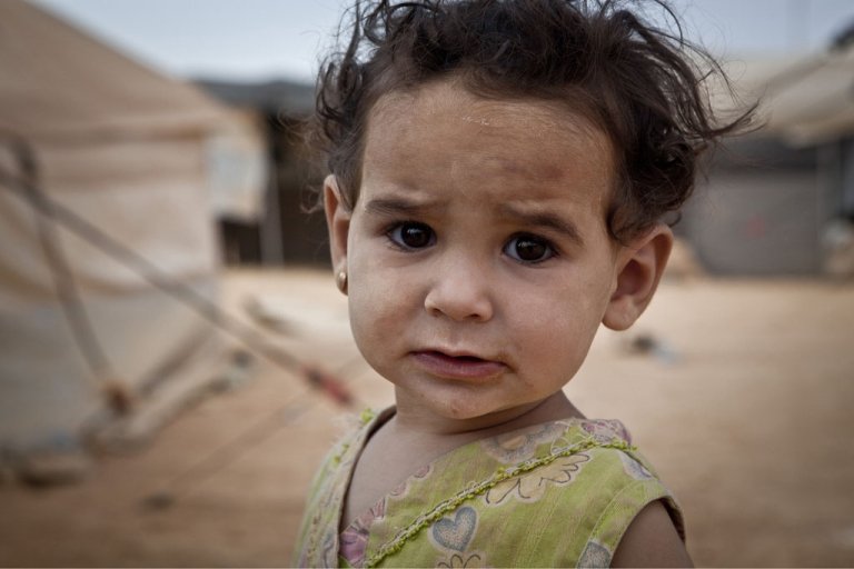 <p>One-year-old Manal at Za'atari refugee camp, Jordan. She's one of thousands of children who have fled across Syria's border to escape an increasingly brutal conflict.</p>