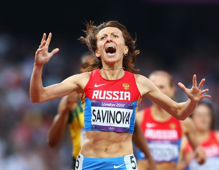 <p>Mariya Savinova of Russia celebrates as she crosses the finish line to win gold in the Women's 800m Final on Day 15 of the London 2012 Olympic Games at Olympic Stadium on August 11, 2012 in London, England.</p>