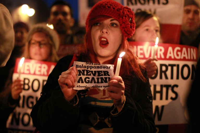 <p>Demonstrators hold placards and candles in memory of Savita Halappanavar during a march to Irish Parliament in Dublin on November 17, 2012. Ireland's tough abortion laws came under fire following the death of the Indian woman after doctors allegedly refused her a termination because it was against the laws of the Catholic country and they could hear a fetal heartbeat.</p>
