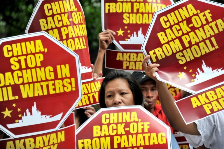 <p>Activists hold a protest in front of the Chinese Consular Office in Manila on April 16, 2012, demanding the Chinese government to immediately pull out from Scarborough Shoal. According to the Philippines said it remained locked in a stalemate with China over a disputed shoal in the South China Sea.</p>
