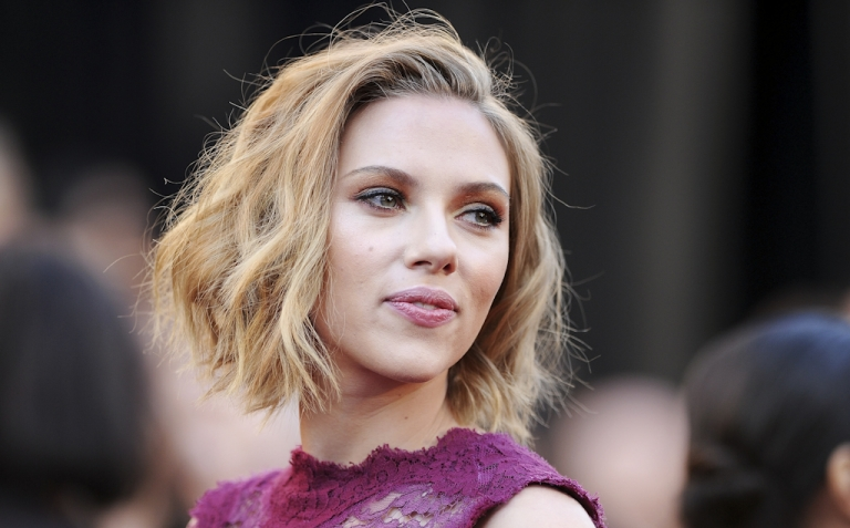 <p>Actress Scarlett Johansson has threatened legal action against anyone who posts the nude photos of her that hit the internet on September 14, 2011. The FBI says it is investigating computer hacking attacks on celebrities.</p>