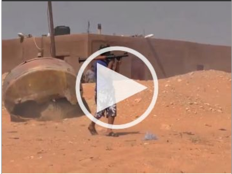 <p>A rebel pushing into Sirte prepares to fire a rocket propelled grenade.</p>