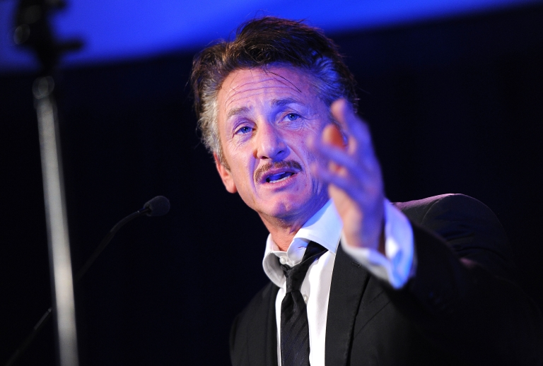 <p>Actor Sean Penn speaks onstage at the Cinema For Peace event benefiting the J/P Haitian Relief Organization on Jan 14 in Los Angeles.</p>