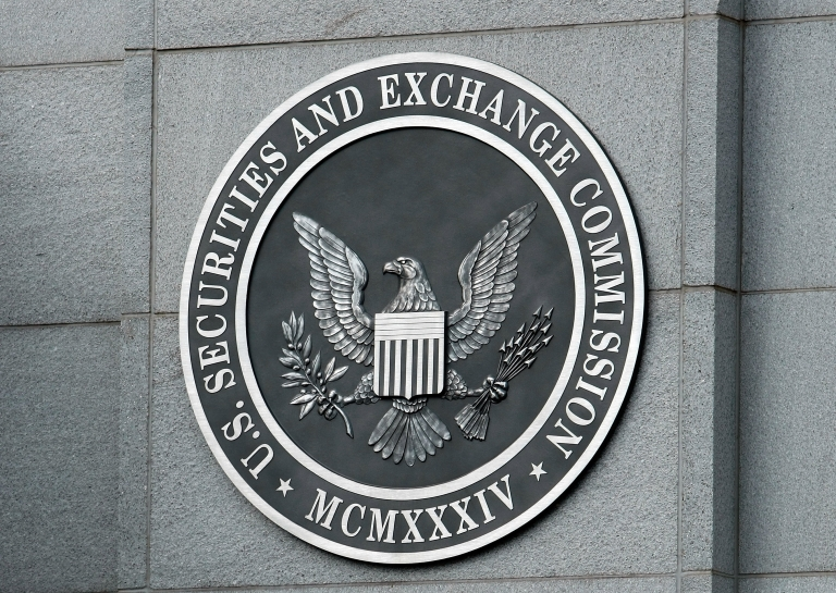 <p>The US Securities and Exchange Commission seal hangs on the facade of its building in Washington, DC.</p>