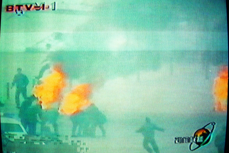 <p>Chinese television footage shows what it describes as Falun Gong members setting themselves on fire, Jan. 23, 2001 in Beijing's Tiananmen Square.</p>