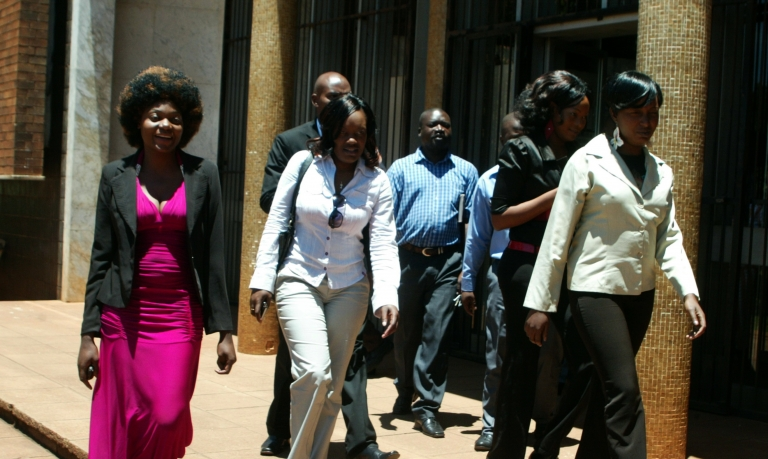 <p>Sisters Sophie Nhokwara (26), Netsai Nhokwara (24) and Rosemary Chakwizira (28) leave Harare Magistrates court on November 29, 2011 after  a pre-trial hearing for attacking male hitchhikers to collect semen for rituals.</p>