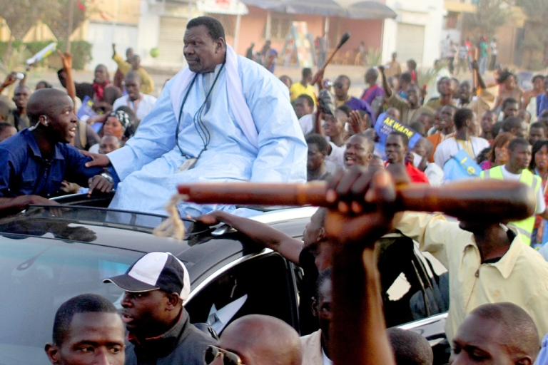 <p>Senegalese marabout Cheikh Bethio Thioune surrounded by his followers in Dakar when he endorsed President Abdoulaye Wade.</p>