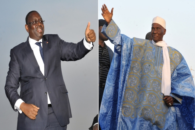 <p>A combination of two pictures taken in Dec. 2011 in Dakar shows (L) former Senegalese Prime Minister and opposition candidate of the Alliance pour la Republique (APR) Macky Sall and (R) current Senegalese president and presidential candidate Abdoulaye Wade.</p>