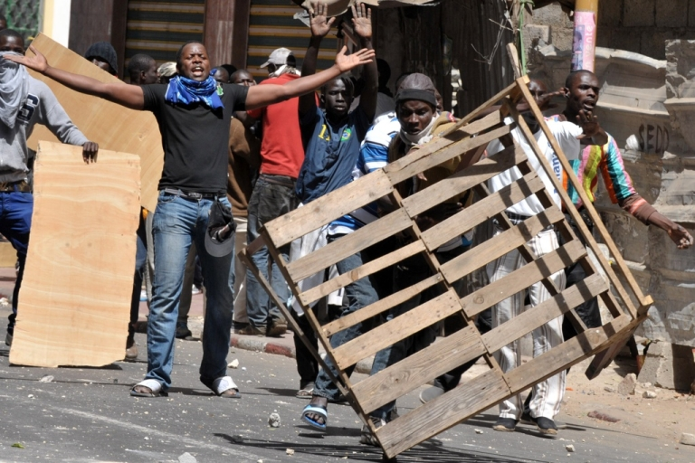 <p>A Senegalese demonstrator carries a piece of wood on February 19, 2012 during clashes that erupted in Dakar with riot police outside a mosque, which demonstrators said had been 'profaned' when it was hit by tear gas grenades thrown by a police officer on February 17. Senegalese riot police fired volleys of tear gas and rubber bullets at stone-throwing demonstrators after prayers at a mosque in the Senegalese capital on February 19.</p>