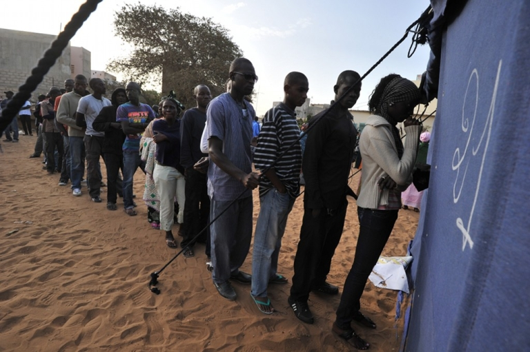 <p>People queue to cast their votes on February 26, 2012 at a polling station in Dakar during Senegal's most contentious election yet as President Abdoulaye Wade seeks a disputed third term.</p>