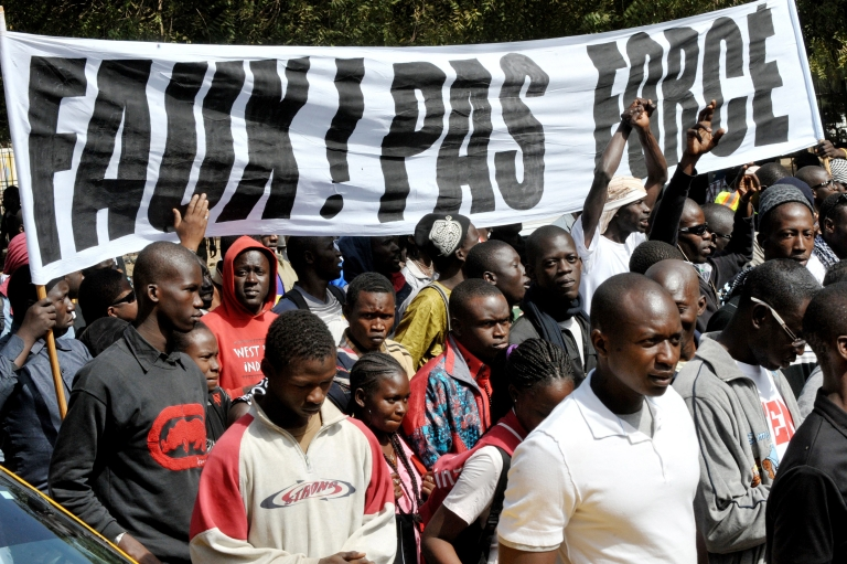 <p>Protesters demonstrate against Senegalese President Abdoulaye Wade's third run for office on January 27, 2012 in Dakar.  Senegal's Constitutional Council announced Monday that the president could run, despite a constitutional clause preventing a third term and public opposition.</p>