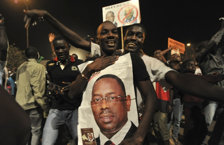 <p>Opposition challenger Macky Sall supporters celebrates their candidate victory at the their campaign headquarter in Dakar March 25, 2012.  Senegal's President Abdoulaye Wade admitted defeat in the presidential election Sunday evening as results gave an overwhelming lead to his rival Macky Sall, state media reported.  The Senegalese Press Agency said Wade