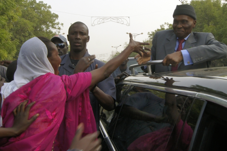 <p>Senegal's President Abdoulaye Wade is greeted by supporters in the streets of Dakar on Feburary 7, 2012. Thousands of opposition supporters marched through central Dakar Tuesday to ratchet up the pressure on the president to abandon his bid for a third term in office.</p>