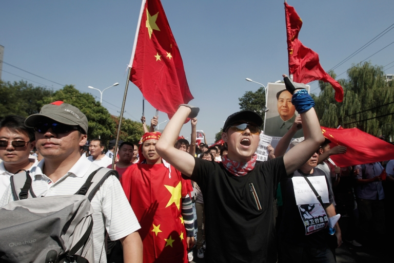 <p>Demonstrators hold flags and a portrait of Chairman Mao during an anti-Japanese protest over the Diaoyu Islands issue outside the Japanese Embassy on Sept. 15, 2012, in Beijing, China. Tensions in the area continue to simmer despite reports that China plans to remain 'non-confrontational' in its foreign policy dealings.</p>