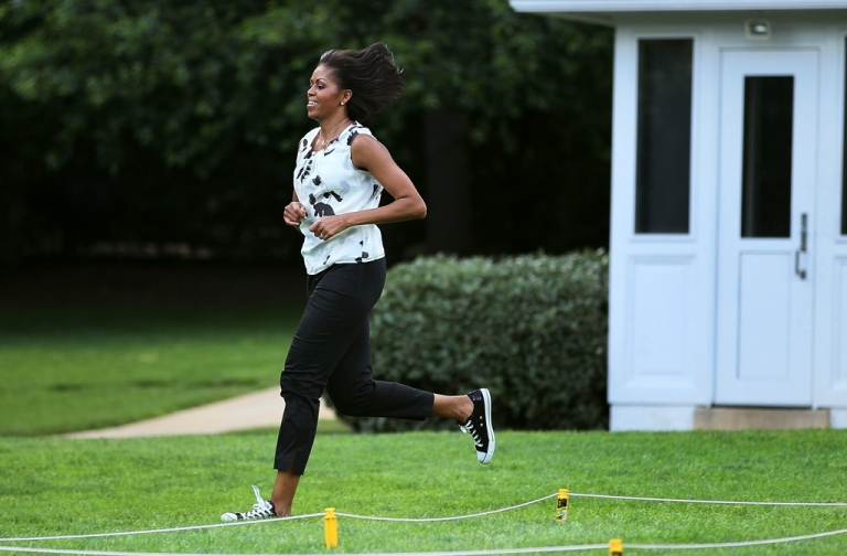 <p>First lady Michelle Obama runs while working out with local students on the South Lawn of the White House on May 25, 2010 in Washington, DC.</p>
