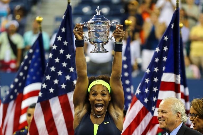 <p>Serena Williams of the United States lifts the championship trophy after defeating Victoria Azarenka of Belarus in the US Open women's singles final today.</p>
