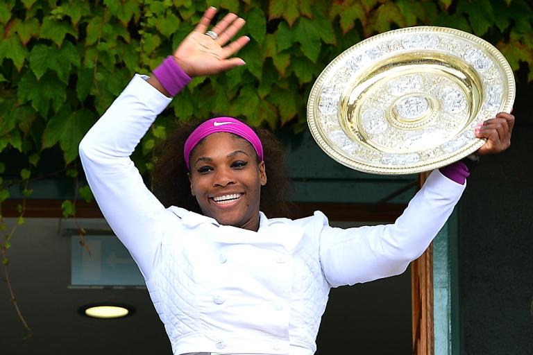 <p>Serena Williams celebrates with the Venus Rosewater Dish after winning the women's final at Wimbledon on July 7, 2010. She beat Poland's Agnieszka Radwanska 6-1, 5-7, 6-2.</p>