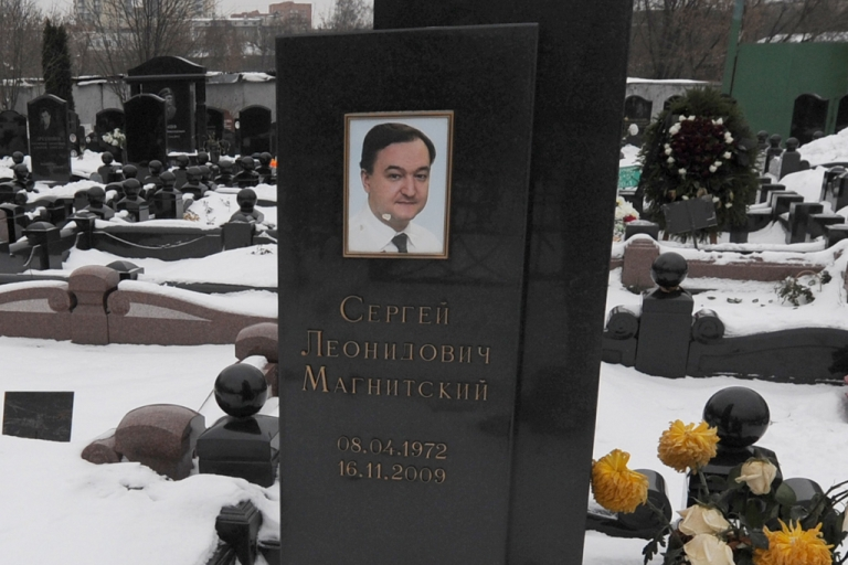 <p>The snow clad grave of Russian lawyer Sergei Magnitsky with his portrait on the tomb at the Preobrazhenskoye cemetery in Moscow.</p>