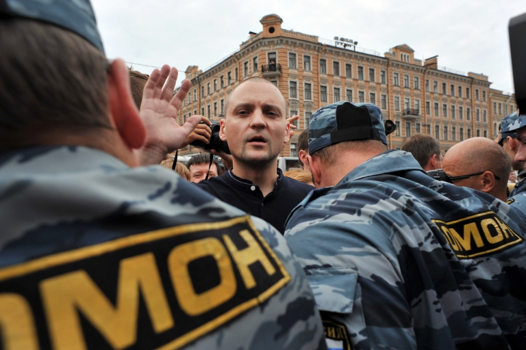 <p>Police detain opposition leader Sergei Udaltsov during an opposition rally in July 2012. The head of the Left Front has been charged with plotting to spread disorder.</p>