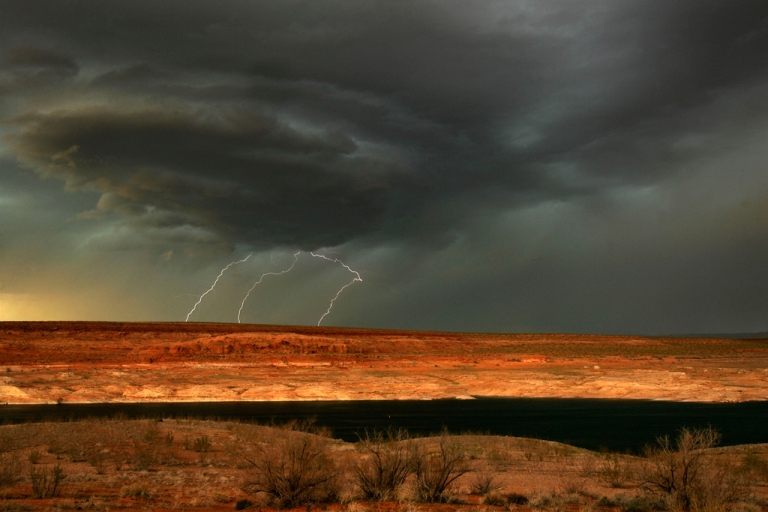 <p>Lightning strikes as a much-needed rain storm comes to Lake Powell near Page, Arizona which is marked by a 100-foot thick