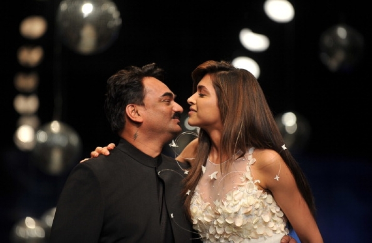 <p>Indian Bollywood actress Deepika Padukone getting dangerously close to a kiss with an Indian designer Wendell Rodricks at the end of the presentation of his collection at the Wills Lifestyle India Fashion Week Spring Summer 2012 in New Delhi on October 10, 2011.</p>