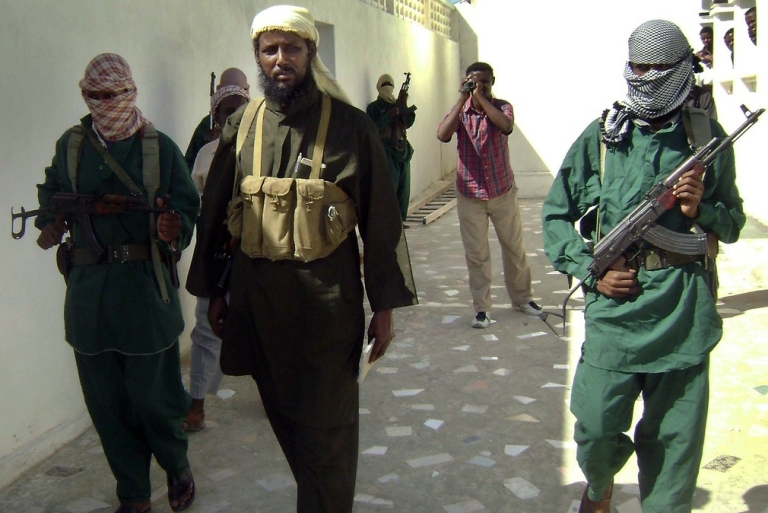 <p>Are these guys really traveling that far from home? Above, Shabaab spokesman Robow Abu Mansur prepares to give a press conference.</p>