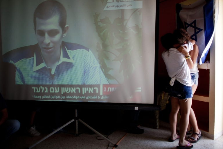 <p>Israelis react after seeing the first images of Israeli Defense Forces soldier Gilad Shalit on TV following his release on October 18, 2011 in Mitzpe Hila, Israel.</p>