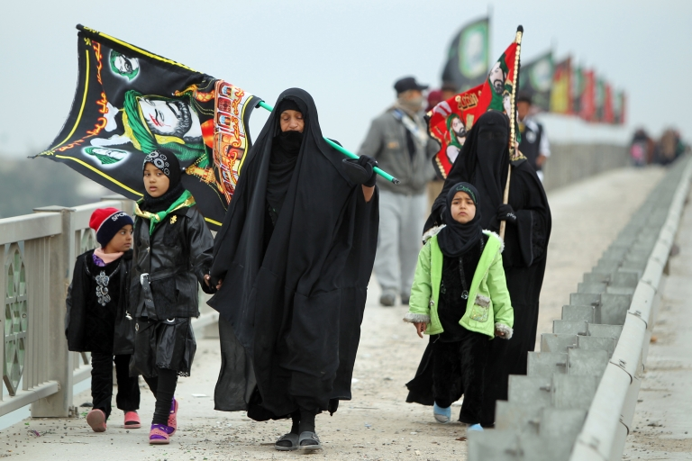 <p>Iraqi Shiite Muslim pilgrims walk on January 6, 2012 through the Dura neighborhood of Baghdad on a main highway linking the Iraqi capital to the central shrine city of Karbala where they will mark the Arbaeen religious festival which is the 40th day after Ashura commemorating the killing of Prophet Mohammed's grandson, Imam Hussein in the seventh century. Two bombs exploded in the morning on separate bridges in the Dura neighborhood of south Baghdad in an Attack against Shiite pilgrims killing two people.</p>