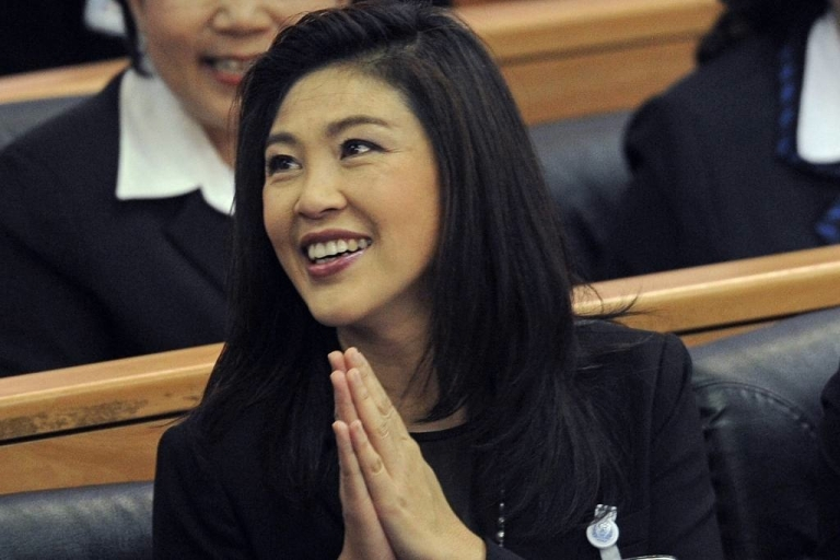 <p>Yingluck Shinawatra greets parliamentarians on Aug. 5, 2011.</p>