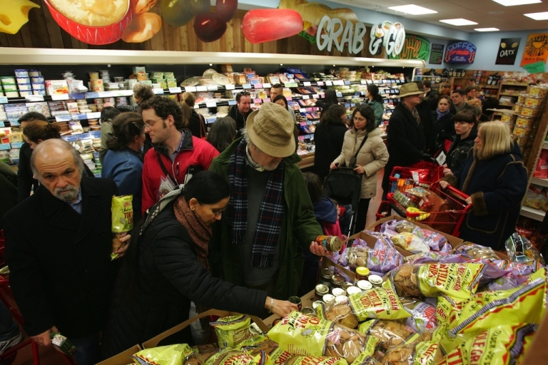 <p>Shoppers line up inside Trader Joe's for the grand opening on 14th Street in New York City on March 17, 2006. Trader Joe's, a specialty retail grocery store, has more than 200 stores in 19 states.</p>
