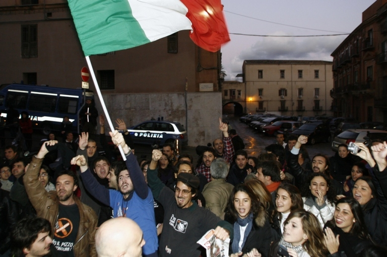 <p>Members of the anti-mafia 'addiopizzo' committee celebrate after the arrest of mafia boss Giovanni Nicchi in December, 2009 in Palermo. Addiopizzo tourism is an emerging trend in ethical travel.</p>
