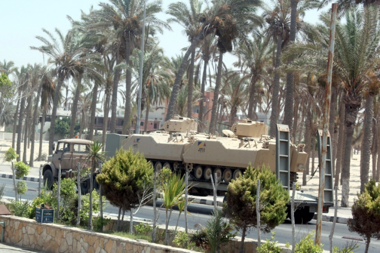 <p>An Egyptian truck carrying armoured vehicles through El-Arish on the Sinai Peninsula in 2011.</p>