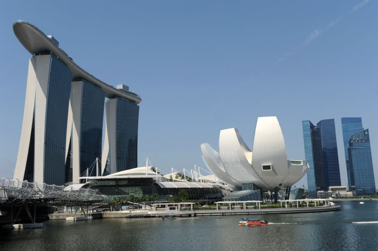 <p>A view of the Marina Bay Sands (L) and financial district highrises (R) in Singapore on June 14, 2012.</p>