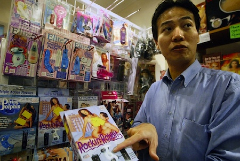<p>The owner of Singapore sex shop 'U4Ria' displays one of the many sex toy on sale in his shop. Despite strong laws against obscenity and generally conservative values, adult shops peddling vibrators, kinky lingerie and dildos are doing good business in Singapore.</p>