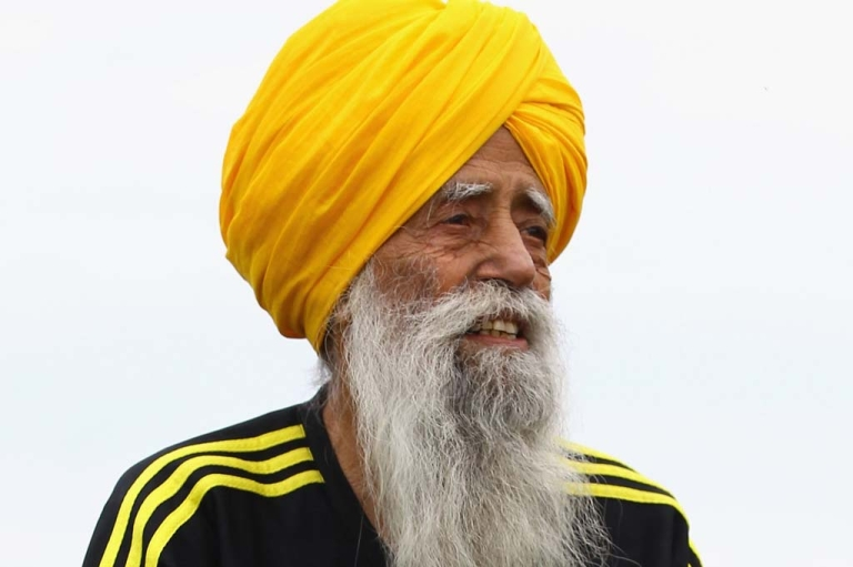 <p>Centenarian Sikh runner Fauja Singh poses for pictures after being the first person to officially enter for next year's Edinburgh Marathon on September 1, 2011 in Edinburgh, Scotland.</p>