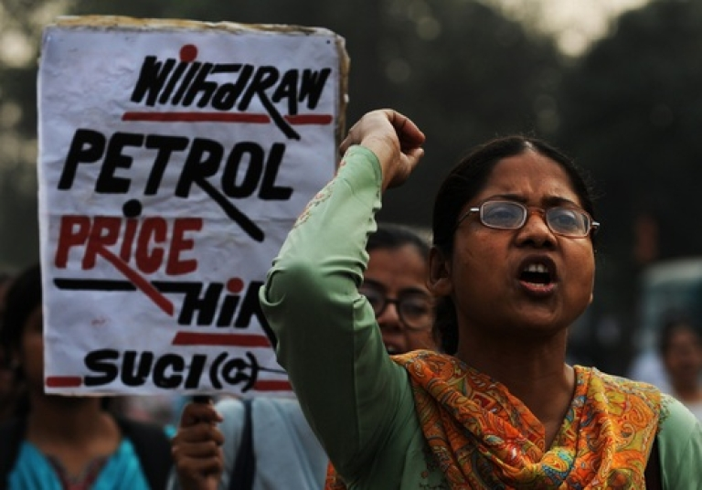 <p>Deja vu? Activists of Socialist Unity Center of India (Communist) shouts slogans during a rally organised in protest against the recent national petrol price increase in Kolkata on November 4, 2011. Look for similar scenes on May 31, as India's opposition parties have called for a nationwide general strike to protest Manmohan Singh's move to hike petrol prices to rein in the plunging rupee.</p>