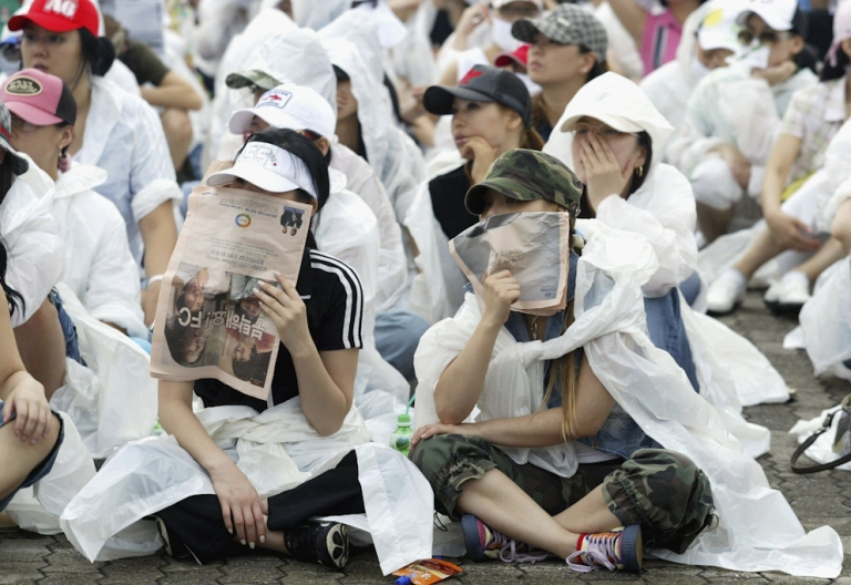 <p>South Korean prostitutes hide their identities as they participate in a rally to declare 'Sex Worker's Day' on June 29, 2005 in Seoul, South Korea. Prostitutes rallied against government law aimed at the sex industry. The government began enforcing new laws last year to target human traffickers, pimps and prostitutes. The sex industry accounts for more than four percent of South Korea's gross domestic product, with its annual sales estimated at $21 billion in 2003.</p>