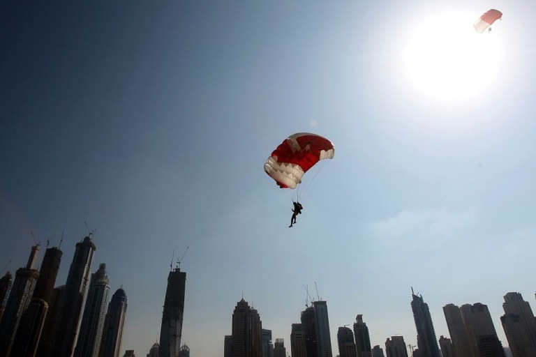 <p>A member of the Bahraini team is pictured above Dubai's skyscrapers during the Gulf emirate's 2nd International Parachuting Championship and Gulf Cup 2011 on January 7, 2011.</p>