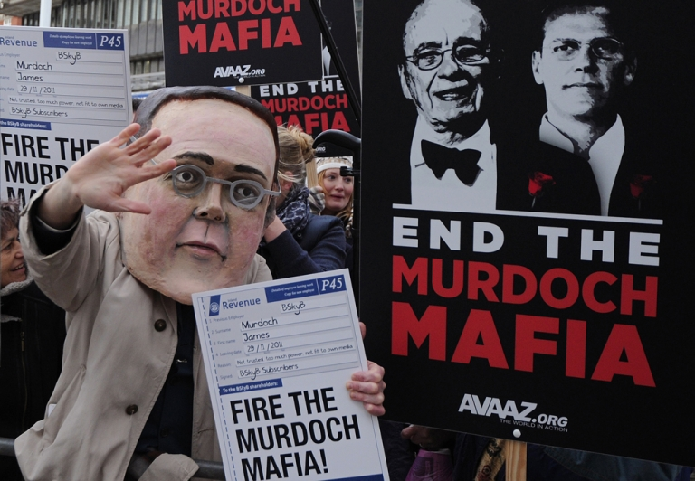 <p>Demonstrators from the campaign group 'Avaaz' protest outside the Queen Elizabeth II centre in London, on November 29, 2011, as BSkyB hold their annual general meeting.</p>